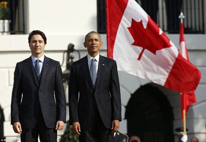3210E21C00000578-3485913-Obama_and_Trudeau_L_listen_to_the_American_and_Canadian_national-a-54_1457625529407